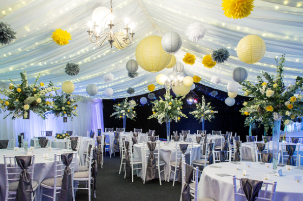 Marquee-lanterns-and-tissue-pom-poms